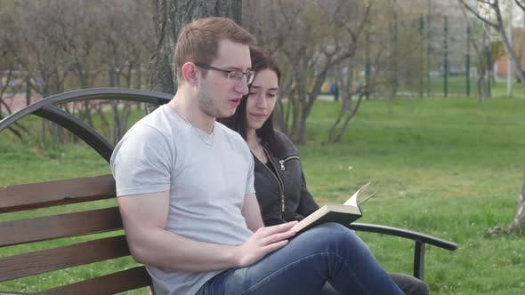 Thumbnail for Beautiful Couple Talking on the Bench in the Park