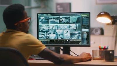 Black Man Watching Security Videos