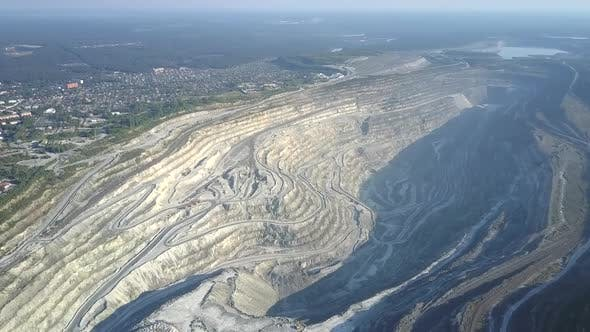 Thumbnail for High Aerial Flight Over Huge Asbestos Pit By Modern City
