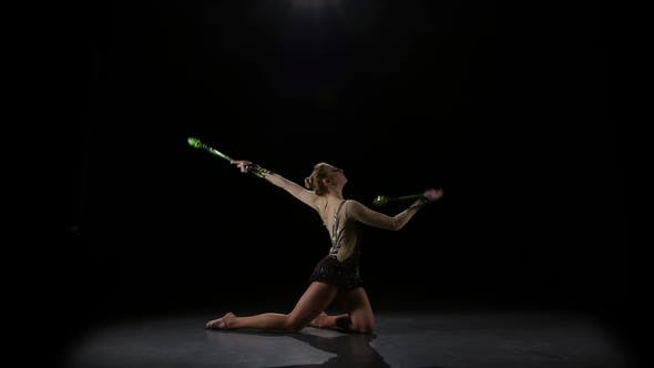 Thumbnail for Girl Gymnast with Mace in Hand Revolve Around Him. Black Background