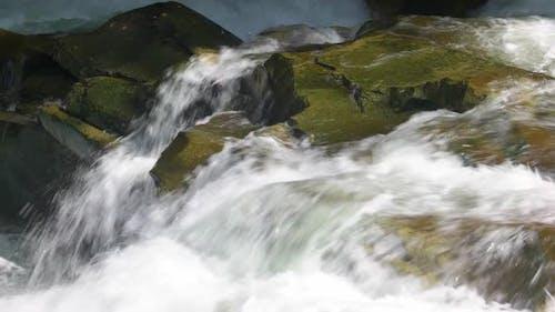 Pure Water Flows Between Stones