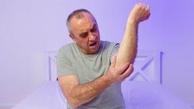 Elderly Man Having Joint Pain Hurt at Home