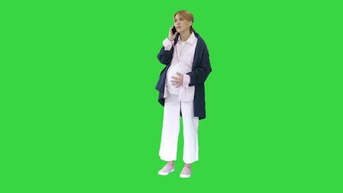 Pregnant Woman with Contractions Feeling Pain Calling Ambulance with Cell Phone on a Green Screen