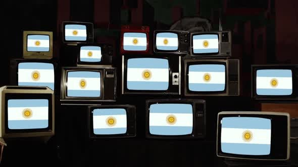 Pile of retro Televisions and the Flag of Argentina.