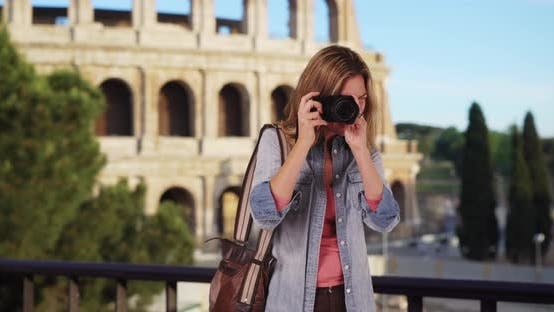Thumbnail for Travel photographer in Rome taking picture outside smiling