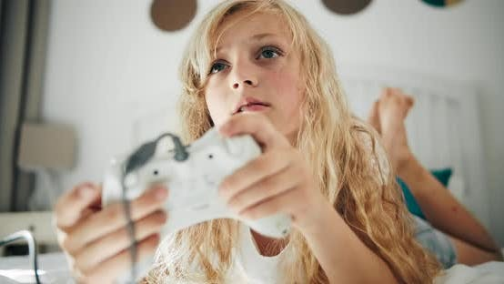 Girl Playing Video Game with Joystick