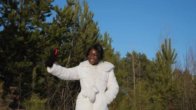 Black Woman Makes Selfie in Winter Forest Under Clear Sky