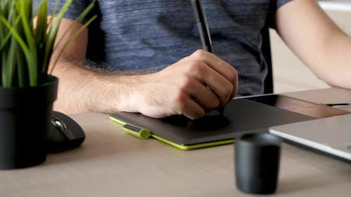 Focus Rack on Designer Working on a Digital Tablet Known As Digitiser