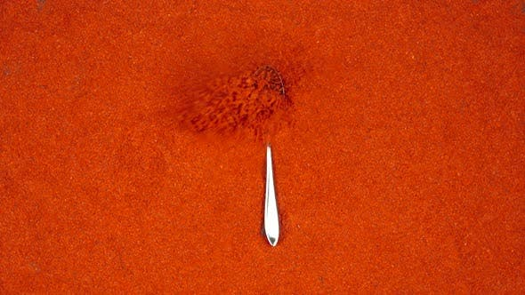Thumbnail for Spoon with a red pepper powder falls on a red pepper powder