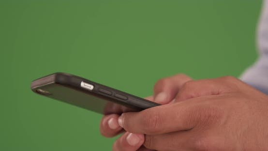 Thumbnail for Close up of male hands sms messaging on smart phone on green screen