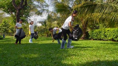 Volunteers Collecting Household Waste