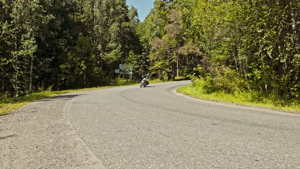 Thumbnail for A Brutal Man Motorcyclist Driving Around the Corner