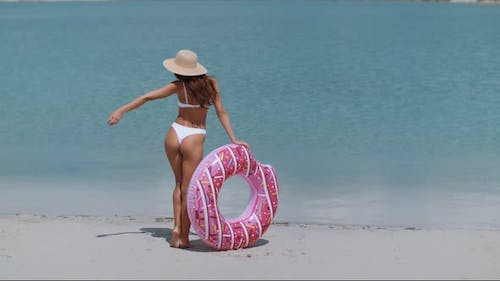 Woman on the Beach with a Rubber Ring