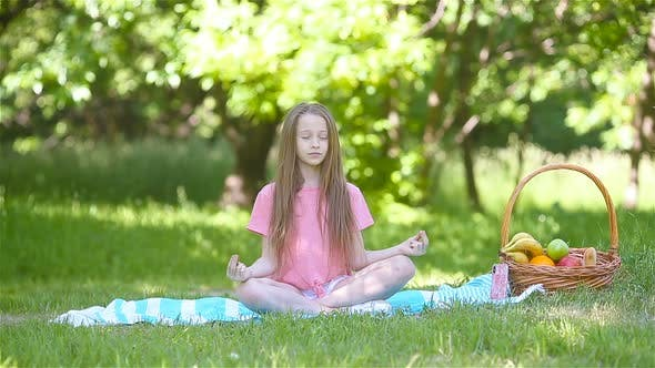 Thumbnail for Little Girl in Yoga Position in the Park.