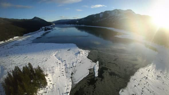 Thumbnail for Snow Covered Lake Keecheleus Pacific Northwest Aerial At Golden Hour