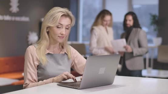 Thumbnail for Portrait of Young Beautiful Caucasian Woman Typing on Laptop Keyboard. Portrait of Confident