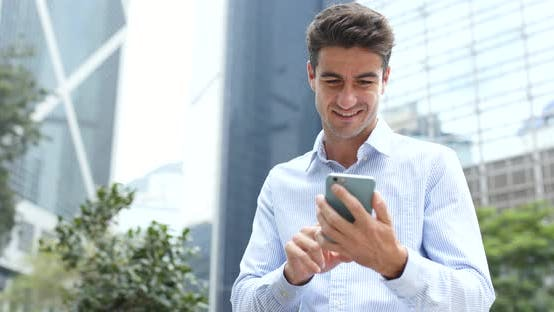 Thumbnail for Businessman use of cellphone in Hong Kong city