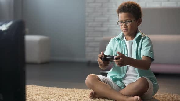 Thumbnail for Male Child Behaving Aggressively While Losing Online Game, Playing on Console