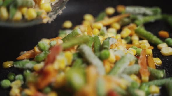 Mix Of Different Vegetables Fried In A Hot Frying Pan