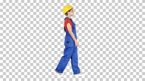 Young woman construction worker in yellow hardhat walking