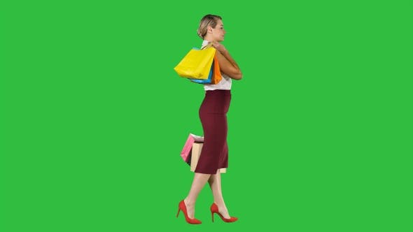 Thumbnail for Happy shopping. Womanholding multicolored shopping bags