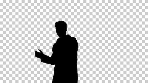 Silhouette man in coat dancing, Alpha Channel
