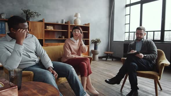 Multiethnic Wife and Husband Talking with Male Counselor during Couple Therapy
