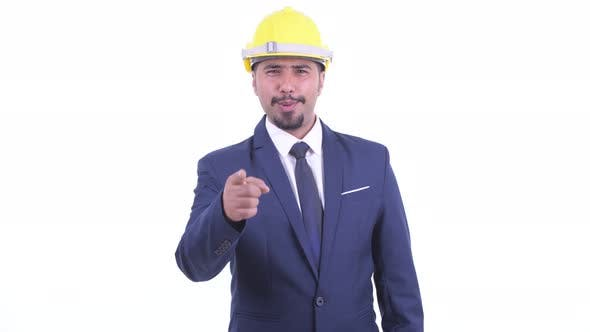Thumbnail for Happy Bearded Persian Businessman As Engineer Pointing at Camera