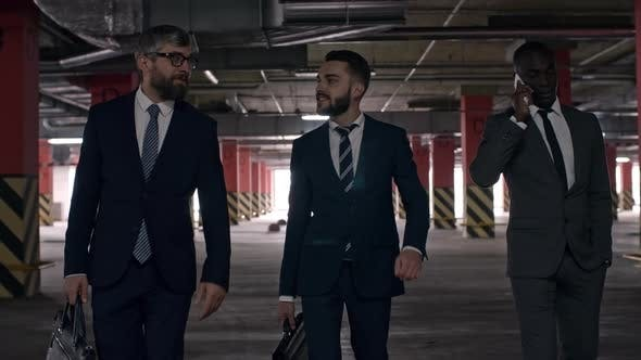 Cover Image for Successful Businessmen Walking through Underground Parking Lot