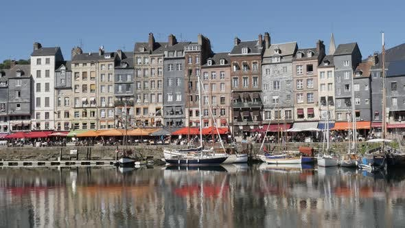 HONFLEUR, FRANCE - SEPTEMBER 2016 Beautiful  architecture reflections on water of famous northern No