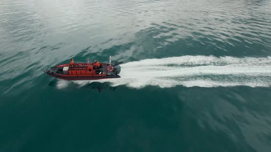 Thumbnail for Aerial View of the Red Speed Boat with Two People on It Rushing Over the Turquoise Water.