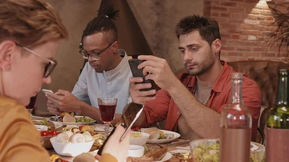 Thumbnail for People Using Smartphones during Dinner