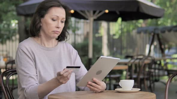 Thumbnail for Online Shopping Failure on Tablet for Old Woman Sitting Outdoor