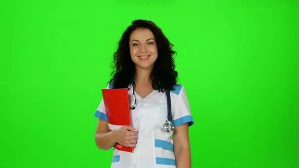 Thumbnail for Smiling Nurse with Stethoscope and Medical Journal in Hand Smiling