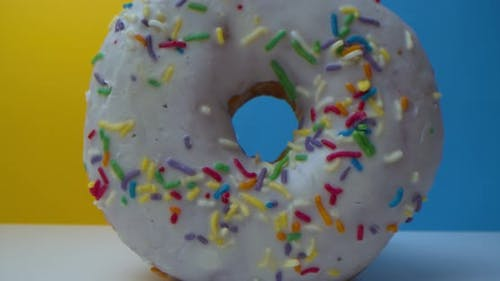 Super Macro Closeup Shot of Delicious Sweet Donuts with Colorful Frosting