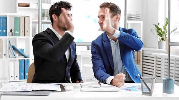 Colleagues High-fiving on Meeting Online