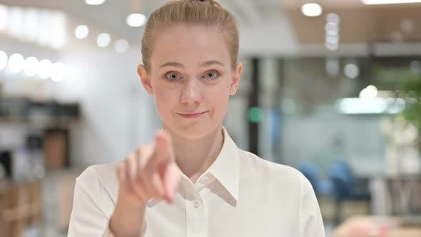 Portrait of Happy Young Businesswoman with Pointing with Finger