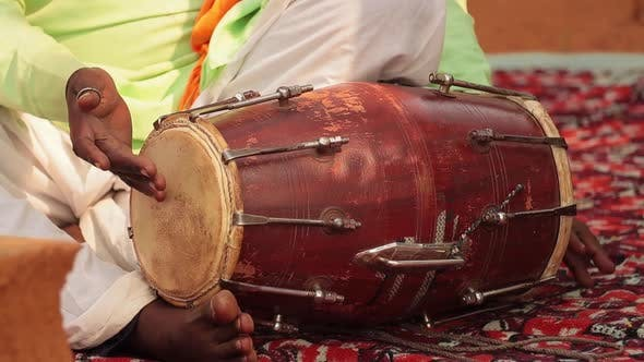 Thumbnail for Drummer Playing Traditional Indian Instrument in the Street
