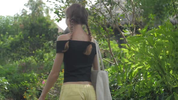 Thumbnail for Young Woman in Yellow and Black Dressing Turns and Walks