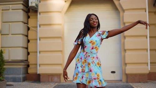 Smiling Afro Girl Dancing Bachata Dress City