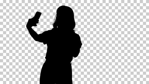 Thumbnail for Silhouette Cute girl making selfie walking, Alpha Channel