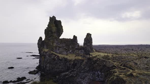Stone Structures Surrounded By Sea Waters and Birds Flying Over Iceland