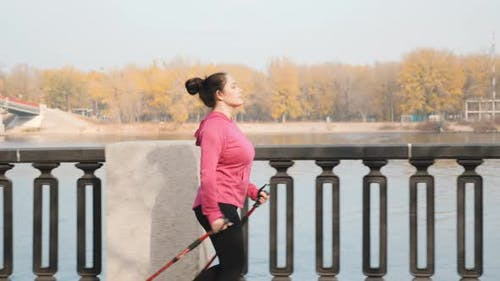 Nordic Walking training in the industrial city along the river and promenade