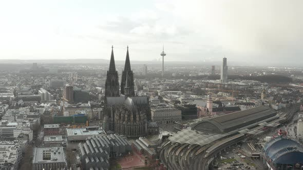 Thumbnail for AERIAL: Circling Around Beautiful Cologne Cathedral with Central Train Station in Beautiful Hazy