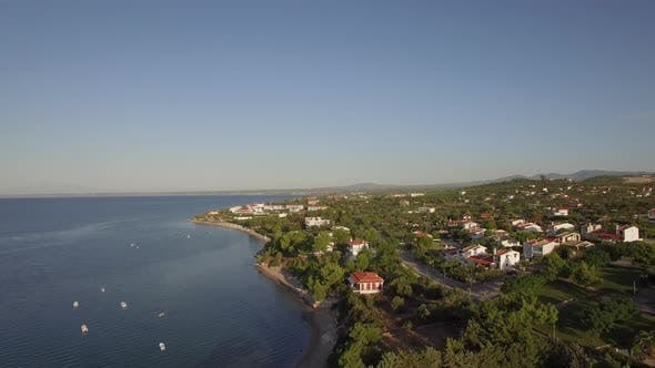Thumbnail for - Coastal Town Scene with Blue Sea. Aerial View of Trikorfo Beach, Greece