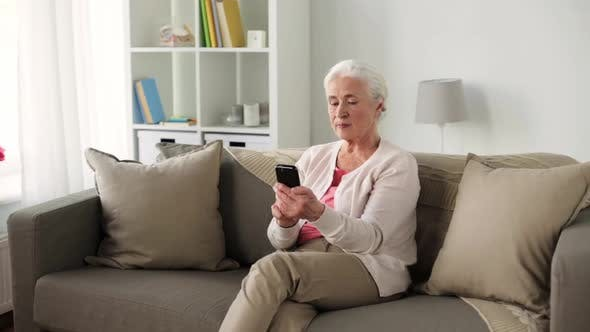 Thumbnail for Senior Woman with Smartphone Messaging at Home