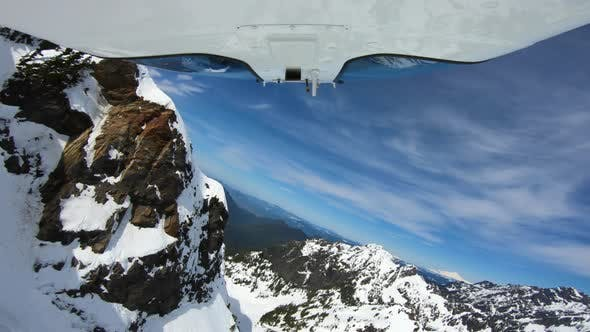 Cover Image for Extremely Dangerous Flight In Helicopter Next To Steep Snowy Mountains In Cascade Range