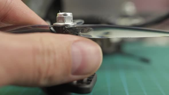 Thumbnail for Extreme Close Up of Young Man's Hands Assembling FPV Racing Drone. Removing Propeller