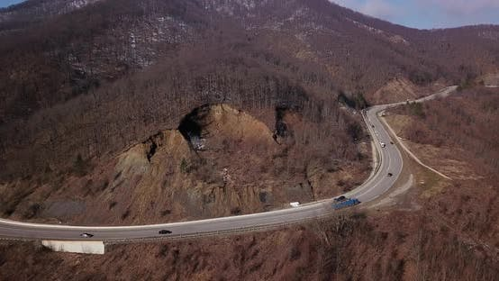 Thumbnail for Aerial Autumn Road From Above View of Cars on a Zig Zag Road. Season Forest Road Landscape. Mountain