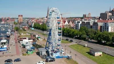 Rising View of Running Ferris Wheel